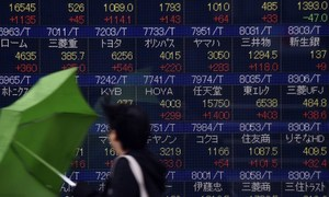 Tokyo stocks fall as yen gains, Nissan surges on buyback