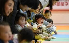 Japan stumbles over baby steps to encourage working mums