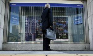 Asia shares, dollar on defensive ahead of US job data, factory surveys
