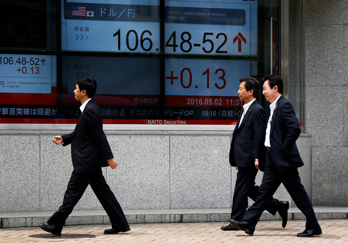 Asian shares trade languidly, dollar edges up