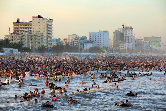 human-tsunami-touches-down-on-vietnam-beach