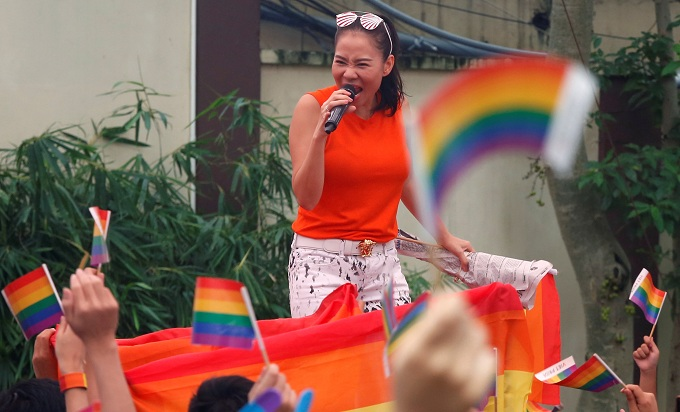 Pop singer Thu Minh performs at the 5th Viet Pride at American Club in Hanoi. Photo by Reuters/Kham