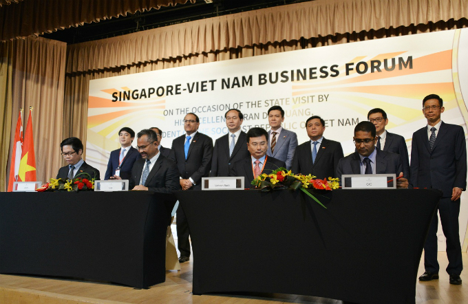 President Tran Dai Quang witnessed the signing of the deal. Photo from Vietcombank
