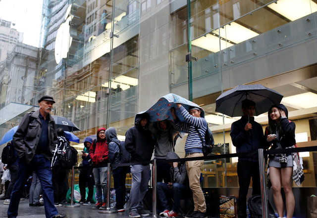 Asian fans snap up new iPhone but crowds smaller despite sell-out