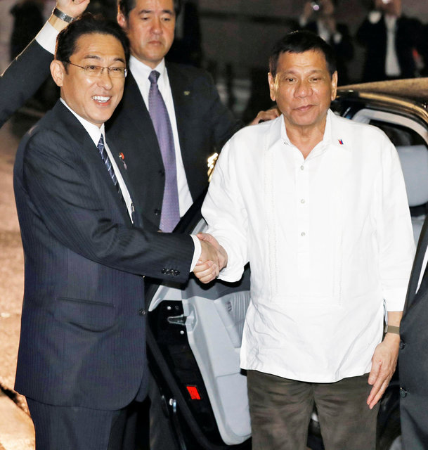 Philippines' Duterte hits out at US, heads to Japan