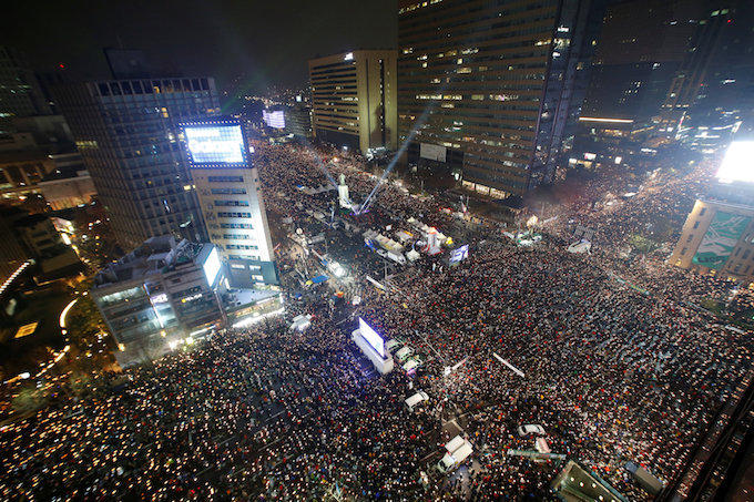 People attend a protest calling for Park Geun-hye to step down in central Seoul, South Korea, November 26, 2016. Photo by Reuters/Kim Hong-Ji TPX IMAGES OF THE DAY