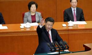 China's Xi says won't let anyone make 'fuss' about its territory