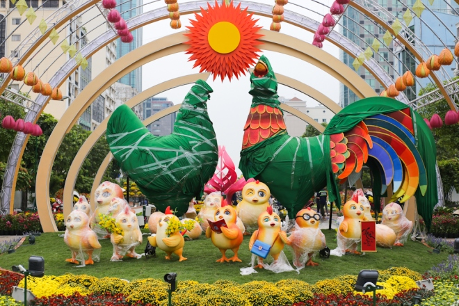"""""""Spring in the city named after President Ho Chi Minh"""" features a couple of giant chickens and many chicks to symbolize the Year of the Rooster."""