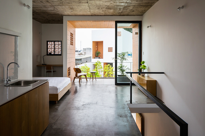 house-in-saigons-narrow-alley-features-patterned-brick-walls-9