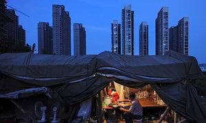 Moody's slashes Hong Kong rating following China cut
