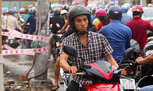 Keep calm and swear as you wait for magic to happen on Saigon roads