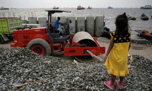 In flood-prone Jakarta, will 'Giant Sea Wall' plan sink or swim?