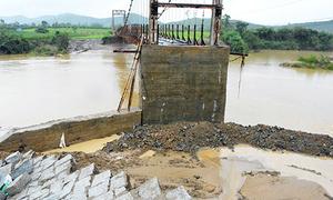 Thousands of people stranded after floods destroy bridge in central Vietnam