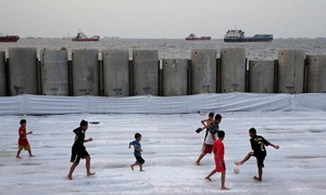 In Jakarta, flood-hit slum residents aim for a higher, drier future