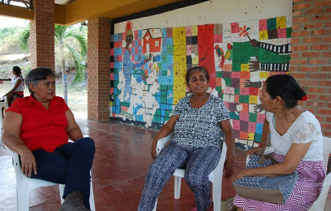 (R to L) Maritza Marimon, Everlides Almanza and Ana Luz Ortega, members of the League of Displaced Women who built Colombias City of Women, have a meeting at the community centre in the Municipality of Turbaco, near the city of Cartagena in northern Colombia, February 13, 2017. Photo by Thomson Reuters Foundation/Anastasia Moloney