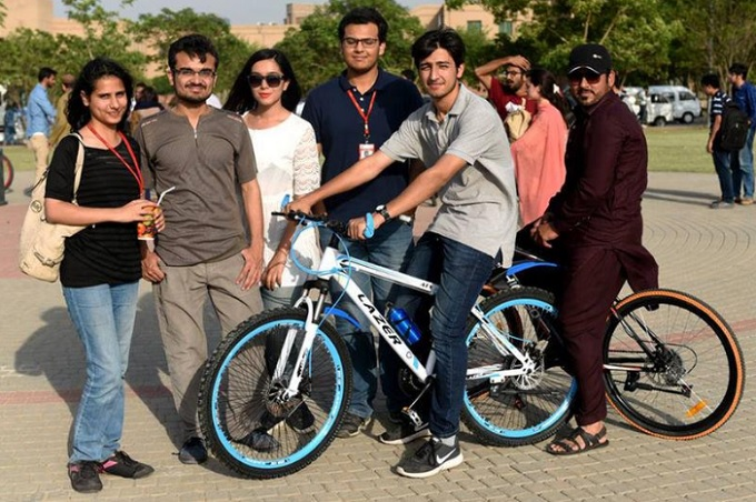 A group of students riding bikes at the soft launch of CYKIQ at NUST campus, Islamabad, Pakistan on May 2017. Photo by Reuters/Picture Courtesy of CYKIQ