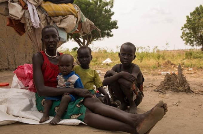 Mary Deng, a Dinka mother has found refuge in opposition-held Ganyiel, escaping food insecurity in her former home. She has brought her three children after her husband died. Ganyiel, South Sudan on October 30, 2017. Photo by Thomson Reuters Foundation/Stefanie Glinski