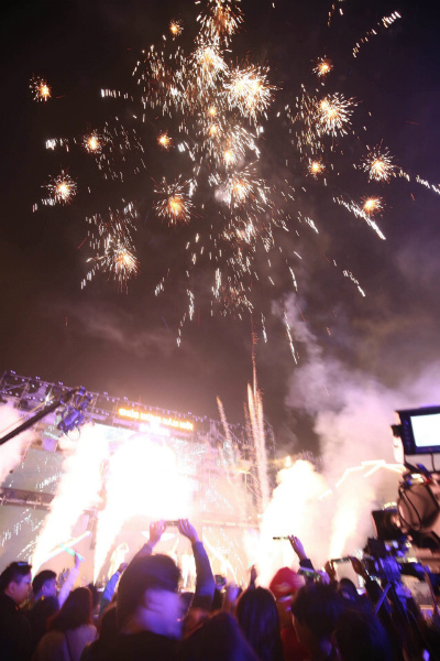 Hanoians enjoy a small fireworks show as the countdown to 2018 hits 0.