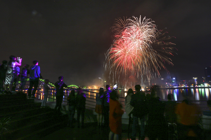 Locals gather along the Han River to watch the spectacle.
