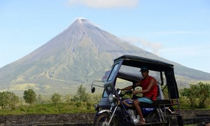 12,000 flee as lava oozes from Philippine volcano