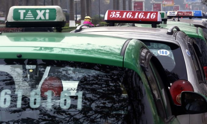 Vietnam's top taxi firm fears bankruptcy in the era of Grab, Uber