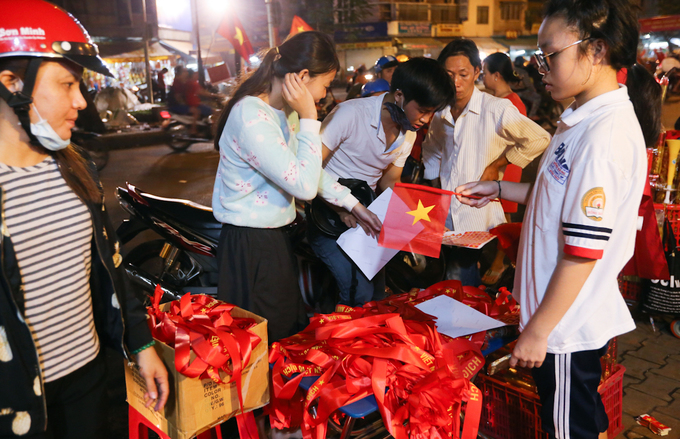 Street side sellers have quickly seized the business opportunity, putting up stalls of flags and plastic trumpets.