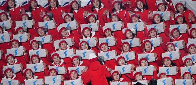 North Korean cheerleaders wave unification flags ahead of the opening ceremony of the Pyeongchang 2018 Winter Olympic Games at the Pyeongchang Stadium on February 9, 2018. Photo by AFP/Roberto Shmidt