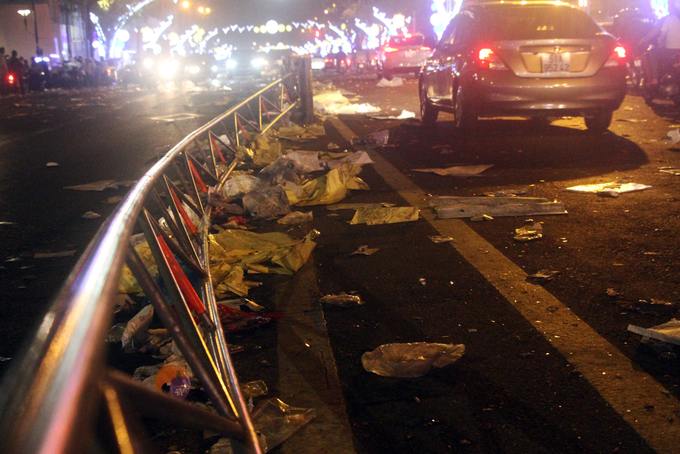 A section of the median strip in Ton Duc Thang street is seen deformed after locals jostled for space to see firework.