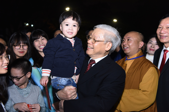 Local people pose for photos with Trong.
