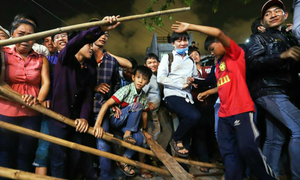 Thousands scramble for luck amid chaos in Vietnam's Mekong Delta