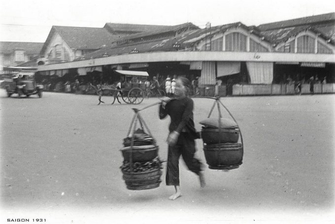 A street vendor is seen behind the market.