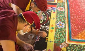 Monks put finishing touches to Vietnam's largest jeweled mandala ahead of grand unveiling