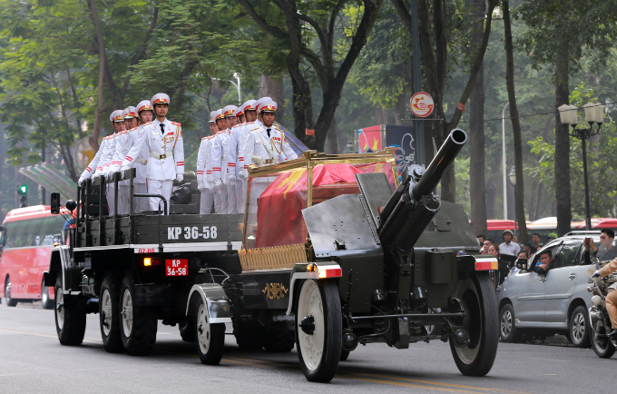 His coffin is covered with the national flag. He was left at the palace for two days for a state funeral, which received generations of Vietnamese leaders and foreign guests.