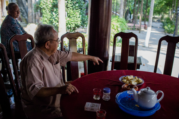 This is where Khai sat every day, Hung said,  pointing to a chair at the temple. He came here every morning, sharing smokes and coffee with old people and taking about  everything. He was humorous and never said any bad things about anyone.