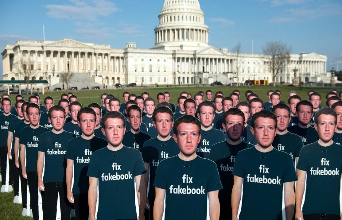 Cardboard cutouts of Facebook CEO Mark Zuckerberg stand outside the US Capitol, placed by advocacy group Avaaz to call attention to what the group says are fake accounts still spreading disinformation on Facebook. Photo byAFP/Saul Loeb