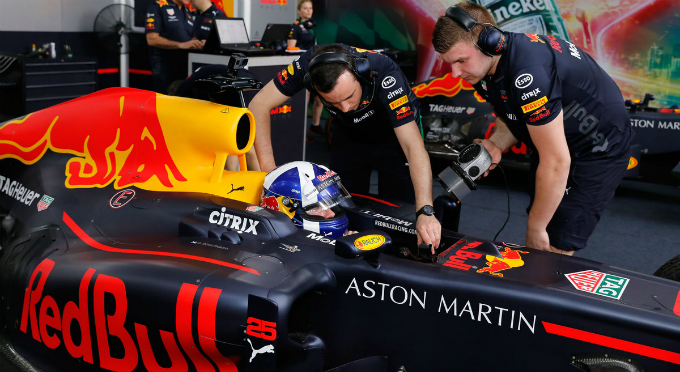 Coulthard, runner-up in the 2001 Formula One World Drivers Championship, is prepared before he drives the car out of a garage for the very first performance of the F1 auto racing in Vietnam on Friday afternoon.