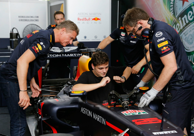 Dutch DJ Martin Garrix is set up before rolling out the F1 racing car on the street of Saigon.