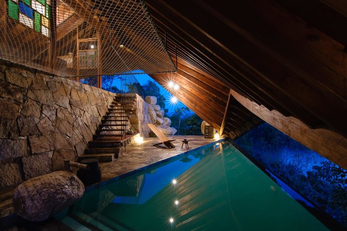 The swimming pool lies under low wooden roof at The Tent Spa, I-Resort in Nha Trang. Photo courtesy of I-Resort