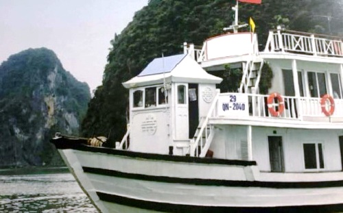 An old image of a cruise ship in Ha Long Bay that was used for advertising.