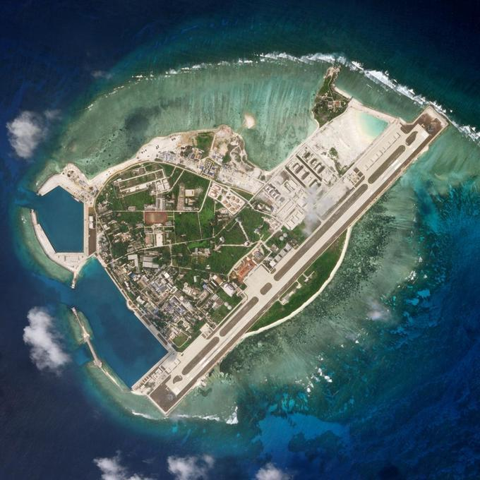 US warships sail near South China Sea islands claimed by Beijing: officials