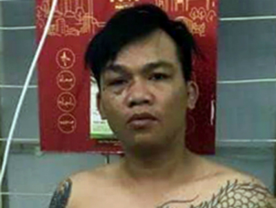 Vo Ngoc Phi, 27, is held in a police station for further investigation. Photo courtesy of HCMC Police