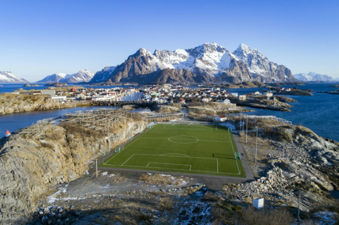 Trapped between icy sea and ice-capped mountains, Henninsvaer FC in northern Norway, boast a bright green synthetic pitch