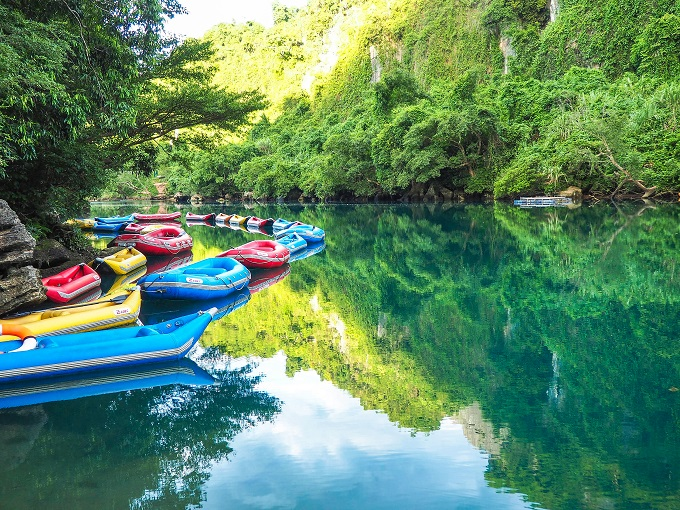 The emerald-like water of Chay River where tourists can enjoy various aquatic sports.