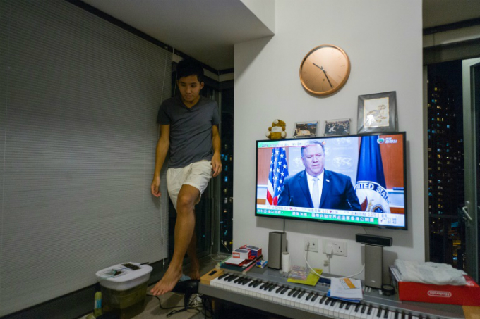 Adrian Law, 25, has adapted to the limited space by buying transformable furniture - his bed folds away against the wall to reveal a desk tucked underneath and he keeps most of his belongings at his parents home. Photo by AFP