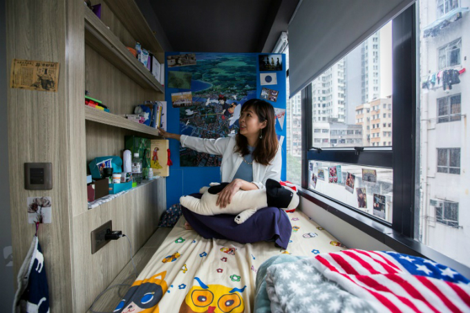 Jezz Ng in a small living space in a co-sharing building in Hong Kong, where box-like nano-flats and co-shares have been touted as fashionable solutions to eye-wateringly high property prices. Photo by AFP