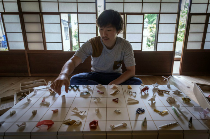 Yuki Tatsumi set off on a year-long road trip in 2016 to ask hundreds of eateries from sushi restaurants to noodle stands to share their transformed paper sleeves with him. Photo by AFP/Quentin Tyberghien
