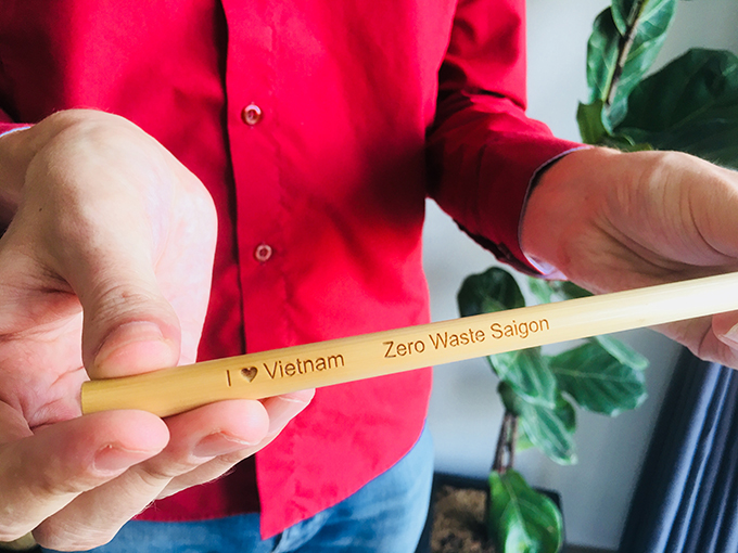 Zero Waste Saigon offers reusable straw made ouf of steel, bamboo, glass and green grass as sustainable alternatives to single-use plastic straws. Michael Burdge showed a bamboo straw at his appartment partly turned into storage place on July 24, in District 4, Ho Chi Minh City. Photo by Hanh Pham.