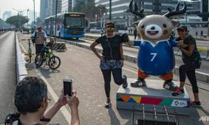 Coming, ready or not: thousands pour in for Asian Games