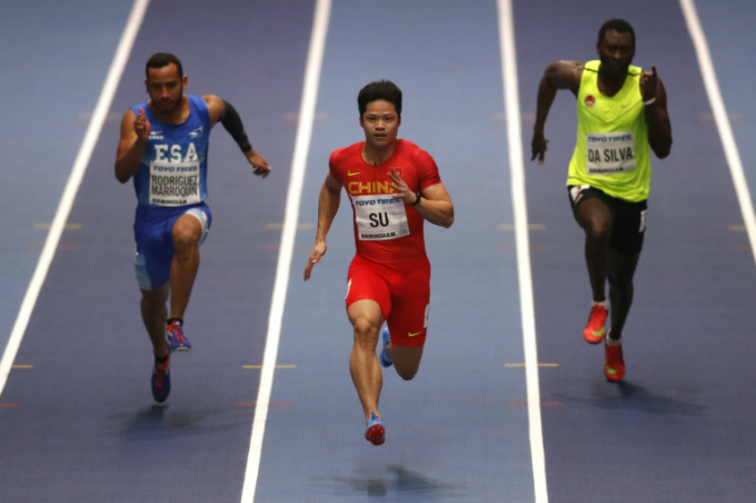 Sprinter Su Bingtian (centre), seen here at the World Indoor Championships earlier this year, is in the form of his life. Photo by AFP/Adrian Dennis