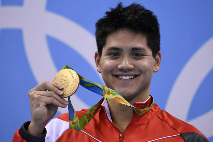 Singapores Joseph Schooling poses with his gold medal on the podium of the Mens 100m Butterfly Final during the swimming event at the Rio 2016 Olympic Games at the Olympic Aquatics Stadium in Rio de Janeiro on August 12, 2016. Photo by AFP/Gabriel Bouys